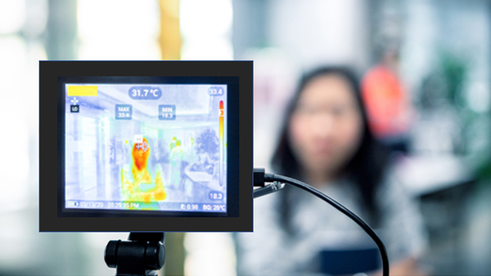 Person getting temperature read by thermal imaging camera